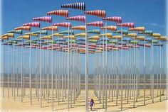 Daniel Buren's Beach Art: The Illusion of a Forest On The Beach