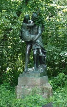 Statue of Hiawatha (Longfellow's Hiawatha) carrying Minnehaha at Minnehaha Park in Minneapolis, Minnesota. Image by Mulad.    A plaque at the site says:        Hiawatha and Minnehaha by Jacob Fjelde        Erected in 1911 by means of funds raised through the efforts of Mrs. L.P. Hunt of Mankato, and contributed principally by the school children of Minnesota.