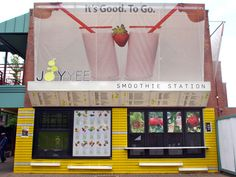 "Joy Yee ""smoothie station walk-up window"" -- bright colors and posters draw people in obviously, large walk-up window with attached shelf-style tables & a bar area (using those same shelves as seating) -- The awning doubles as a menu!!! smart idea!"