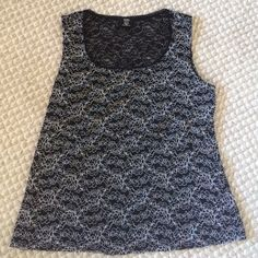 Holiday Sale  Black blouse with a white design all over. Worn a few times, still in perfect condition! Size 18-20 Studio 1940 Tops Tank Tops