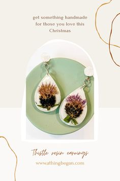 Dried thistle enclosed in resin earrings. Get them from athingbegan.com