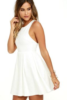 The Sweet Queen Ivory Lace Skater Dress is perfect for those who love an extra spoonful of sugar AND whipped cream on top! Medium-weight woven fabric, with ivory lace overlay, constructs this sweet little dress with a darted sleeveless bodice and pleated skater skirt. Racerback. Hidden back zipper/hook clasp.