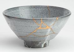 Bowl mended with the Japanese Kintsugi technique. The cracks are filled with gold to enhance instead of trying to cover.