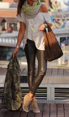 .What a great way to mix sexy leather leggings with a cash booties, army fatigue jacket!