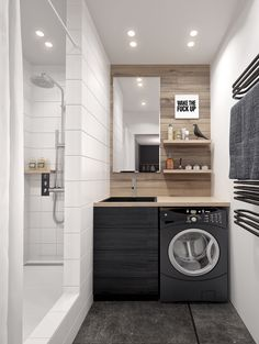 A small bathroom with built in laundry tucked under the counter is a finishing touch on this efficient but stylish design.