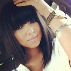 Mid length dark hair with bangs.... love her style