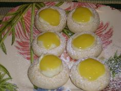 Lemon White Chocolate Cheesecake Thumbprints-  Thumbprint cookies filled with tangy lemon curd and a creamy white chocolate filling