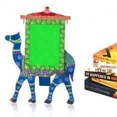 This camel shaped photoframe is a must to accentuate the beauty of your table. The photoframe has been handcrafted in blue and green colour. photoframes