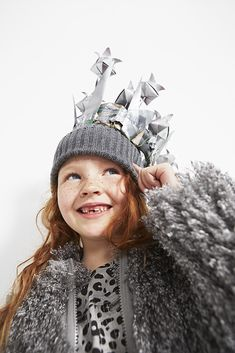 Kids fall 2015 fashion by Stella McCartney Kids. Sparkles coat £124, dress £69 and hat £51