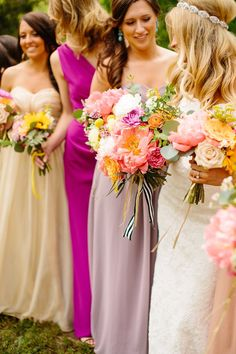Mismatched bright colored #bridesmaids Photography: Tucker Images - www.tuckerimages.com  Read More: http://www.stylemepretty.com/2014/08/05/colorful-boho-diy-wedding/