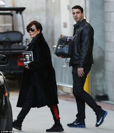 Nice purse holder: Kris Jenner clutched Tony Robbins' third self-help book while leaving h...