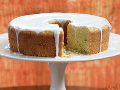 Lemon-Rosemary Olive Oil Cake | Rosemary lends evergreen essence, while olive oil enhances the flavor and maintains the moist texture of this Mediterranean-inspired cake. You can prepare it up to 2 weeks ahead and freeze, unglazed; top thawed cake with glaze before serving to your guests. Casual yet elegant, it's a fine finish for a dinner party featuring Spice-Rubbed Braised Beef, though it also makes a well-chosen addition to a dessert buffet.