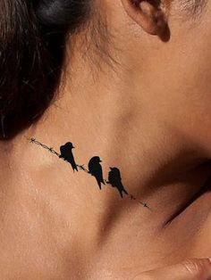 On A Wire Bird Tattoo - AsIfTattooed.com
