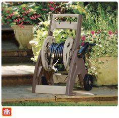 The durable, contemporary design helps to keep your hose neat and tidy. Hose Cart, Sprinkler Hose, Garden Sprinklers, Hose Reel, Gardening Tools, Neat And Tidy, Home Hardware, Lawn And Garden, Contemporary Design