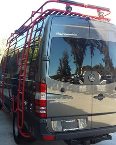 Great color combo! Aluminess roof rack, ladder and surf hooks on a Mercedes Sprinter van.