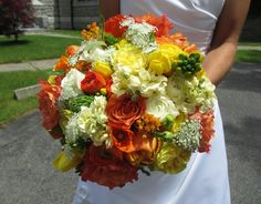 love the colors and the orange flower with green center!