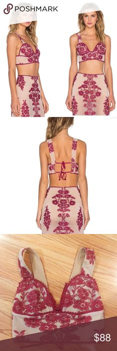 """For Love and Lemons Temecula Crop Top in wine NWOT. Purchased from a sample sale - never worn and size tag missing. Fits like a M but is adjustable from a S to L because of the ties on back. Fabric measures 25"""" around at bottom hem. Ties are 11"""" each. A knockout for a knockout. The Temecula Top by For Love & Lemons comes in nude mesh and features red floral embroidery throughout, back tie closure full nude lining, and scalloped hem at bust.   *Cotton/Polyester/Spandex  *Dry clean only…"""