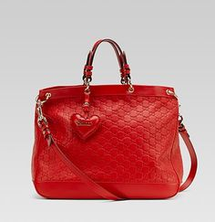 valentine bag with hand stitched heart-shaped leather charm and gucci script logo from Gucci at 150 WORTH.