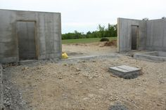 2 triangular-shaped concrete safe rooms in the basement area of a log home
