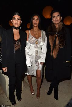 Family: Kim is pictured flanked by older sister Kourtney and mother Kris Jenner at the Givenchy presentation on Sunday evening as they have been enjoying Paris Fashion Week