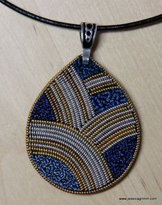 Metal thread embroidery pendant. Design: Tanja Berlin. I've substituted the kit materials to suit my colour taste. Buy your kit at: https://www.etsy.com/ca/shop/TanjasHandEmbroidery?page=1