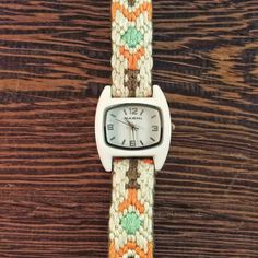-Small White Enamel Watch Face  -Cotton and Silk Embroidery  -Magnetic Clasp  -Ecru, Brown, Tangerine, and Turquoise  -Length Made to Order    This new project has been my baby for the last 6 months.  Behind the scenes I've been developing a small group of embroidered watches that are trendy, fun, and colorful.  The Mina Watch is a spin off of the Nori, with the same face in silver but a different patterned band.    This watch features a small white enamel  face that measures 28mm.  The…