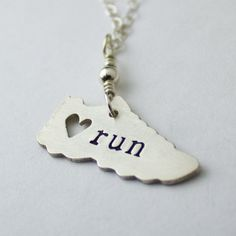 My sterling silver I love running necklace. I hand cut this little shoe from sterling silver sheet and hand stamp the word run or a distance. www.abellablue.com