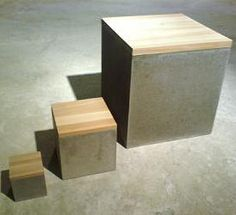 Concrete box with a wooden top.
