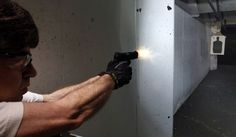 Dimitry Lazar fires his 9mm pistol at targets at the Firing-Line indoor range and gun shop, Thursday, July 26, 2012, in Aurora, Colo. The massacre inside a crowded Colorado movie theater has prompted a sudden increase in gun sales and firearms training. (AP Photo/Alex Brandon) ** FILE **