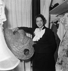 * Elsa Schiaparelli Holding Large Hat Original in the dressing room. Photo Sylvia Salmi