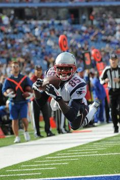 Brandon Lloyd with a beaming smile and ball in hand during Sunday s game  between the New England Patriots and Buffalo Bills have become known as the  ... 8ad47d93f
