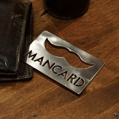 Man Card ™ (Bottle Opener) by Man Steel - tied to a bottle of beer for the fathers and groomsmen waiting in the groom's room.
