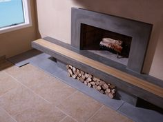 Concrete Fireplace Hearth with Wood Inlay and Surround(Etsy のTaoConcreteより) https://www.etsy.com/jp/listing/93774502/concrete-fireplace-hearth-with-wood