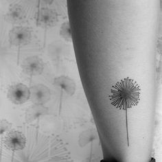 Dandelion tattoo really like the simplicity of this one...would want seed pods flying off though