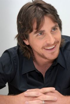 A Christian Bale smile to cheer me up this stormy work week.