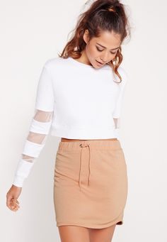 this drawstring jersey skirt is top of our wish lists for summer. super versatile, you can totes wear this with whatever you fancy this season; from ribbed crops and sandals for a ballin' day time vibe, to long sleeved jumpers with sneakers...