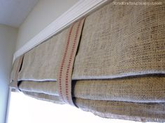 KrisKraft: Ryan's DIY Roman Shades in burlap and furniture webbing. Don't know if you will like them, but I think they are cool...and cheap....and cool.