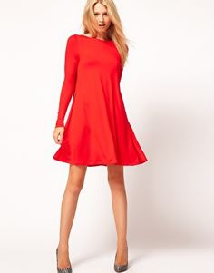 ASOS Swing Dress With Long Sleeves  $42.58  This dress by ASOS Collection has been crafted from a stretch jersey. The details include: a crew neckline, slim fit long sleeves and a flared swing shape. The dress has been cut with a regular fit.