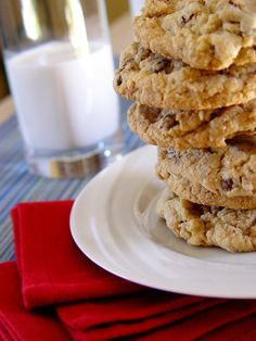 Neiman Marcus cookies. I don't know if this is the original recipe. I made these cookies years ago and lost my recipe. They were FABULOUS!! You must use a food processor to make these cookies but they are worth the effort!! The ground oatmeal flour and the ground chocolate make such a yummy cookie. Use GOOD chocolate and chunks over chips.