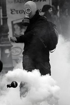 Black and White riots gas mask tear gas smoke grenade