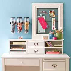 Part of the fun in any DIY organization project is figuring out how to use what was once wasted space in productive, pretty ways. Here, the solution is simple: A vintage frame, a magnetic chalkboard, and a few wall-mounted canisters keep crafts and office supplies in charming order. Swap out the canisters for a larger magnetic corkboard if more display space is needed, and include a few smaller canisters to separate pens and pencils. /