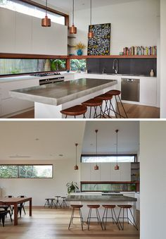 12 Inspirational Examples Of Letterbox Windows In Kitchens // The lower letterbox window in this kitchen replaces a backsplash, while the upper one adds to the bright and airy feeling of the entire home, as it carries light throughout the rest of the bottom level of the house.