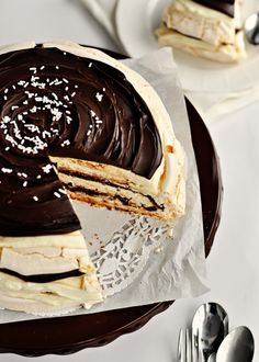 Mascarpone Meringue Cake.   Baked meringue, as a cake layer in this dessert, yields 3 layers of amazing taste and texture, sandwiching the fluffiest, creamiest, and most flavourful mascarpone/whipped cream/Creme de Cacao filling, and then, oh, and then, layers of rich, dark, truffle-textured chocolate ganache swirled in between it all. How could a dessert not be decadent with 2 cups of mascarpone?