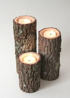 centerpiece - rustic log candle holders. que linda idea para decoracion en navidad.