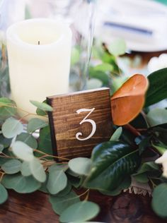 Candle and Greenery Centerpiece | photography by http://jennamcelroy.com/