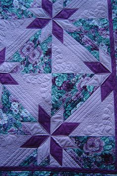 purple & turquoise - what an awesome combo!  Is that a butterfly I see in quilting design?  Clever...