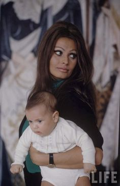 Sophia Loren and Baby, 1969 Amal should try this hairdo & cats eye make-up for a fun new look it would totally suit her !!!