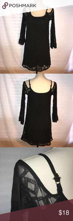 Xhilaration Cold Shoulder Dress, Size XS This Little Black mini dress is in good condition and has very little signs of wear. It is a cold shoulder type dress with long sleeves and Spaghetti straps. The shell is 100% cotton and the lining is 100% polyester.  Pit to pit is 14 1/2 Length is 28 Inches. Xhilaration Dresses Mini