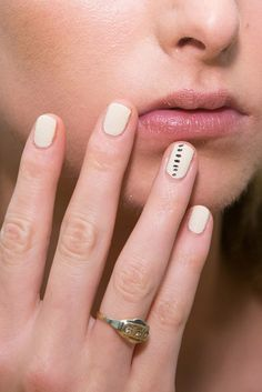 The graphic nail art at Tibi was created by Jin Soon Choi using Georgette — a nude color — as the base and Chamonix to finish the look.
