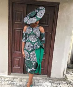 Ankara Gown With An Exposed Sleeves And A Brim Hat